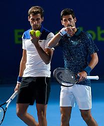 BEIJING, Jan. 1, 2019  Marko Djokovic (L)  and Novak Djokovic of Serbia react during a doubles match against Mubarak Shannan Zayid of Qatar and Cem Ilkel of Turkey at the ATP Qatar Open tennis match in Doha, capital of Qatar, Dec. 31, 2018. Marko Djokovic and Novak Djokovic won 2-1.  XINHUA PHOTOS OF THE DAY (Credit Image: © Nikku/Xinhua via ZUMA Wire)