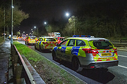 © Licensed to London News Pictures. 19/12/2019. London, UK. Police vehicles parked on the A1 attending the scene where two males were located with stab wounds after reports of a fight nearby. Police were called to Courtland Avenue, NW7, at 20:11GMT following a report of a fight in progress. Officers attended however no trace of any victim or suspects was found. At 20.27GMT, police were called by the London Ambulance Service to Barnet Bypass, near Scratchwood Park, to reports of a man, in his 20s, with stab injuries. Officers attended. The man was treated at the scene by paramedics before being taken to hospital. After a search of a car found at the scene, a man, in his 30s, was found inside a vehicle with stab wounds. Despite the efforts of emergency services, he was declared dead a short time later.. Photo credit: Peter Manning/LNP