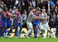 Football - 2018 / 2019 Premier League - Crystal Palace vs. Newcastle United<br /> <br /> Wilfried Zaha of Palace is separated from Newcastl's Kenedy after a scuffle, at Selhurst Park.<br /> <br /> COLORSPORT/ANDREW COWIE