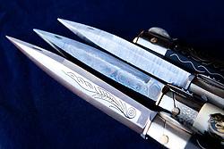 """Avigliano (PZ), 04-10-2010 ITALY - Vito Aquila, artigiano di Balestre. Il coltello di Avigliano, comunemente conosciuto come """"balestra"""", impreziosito con decorazioni in argento e ottone che le conferivano un certo valore non solo artistico,ha identificato per tutto l'Ottocento e parte del Novecento il carattere fiero e risoluto del popolo aviglianese, come attestato in una lunga casistica di riscontri documentari. La """"balestra"""" è un'arma a tutti gli effetti, ed è già considerata -nell'ambito delle manifatture di ferro - oggetto di pregio. Per l'approvvigionamento dell'argento e dell'ottone destinati alla decorazione del manico del coltello gli armieri si rivolgevano agli orefici o agli ottonari. La """"balestra"""" era un'arma del popolo, pronta ad essere impiegata, a seconda delle circostanze, per la difesa o l'offesa tanto dagli uomini quanto dalle donne. Queste, la ricevevano come regalo di fidanzamento dal rispettivo promesso sposo per meglio difendere il proprio onore, perpetrando un'usanza molto sentita almeno fino ai primi decenni del '900..Nella Foto: Particolari della lama."""