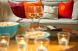 Cosy Sofa and Coffee Table with Wine, Snacks and Tea lights