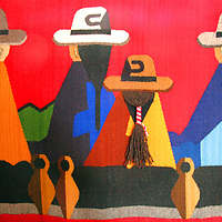 South America, Ecuador, Otavalo. Woven wallhangings displaying scenes of Andean life and culture, handmade by weavers of Peguche and sold at Otavalo Market.