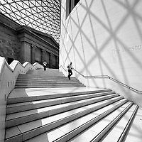 A man runs down the stairs in the British Museum