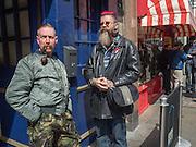 2 men outside pub in Old Compton St. Soho, London. 21 April 2016