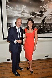 CHARLIE MAYHEW and ELIZABETH OFFORD at a private view of photographs by renowned wildlife photographer David Yarrow in aid of TUSK entitled 'Wild Encounters' held at Somerset House on 19th September 2016.