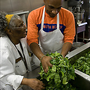 """Sister Jean with volunteer washing collard greens three times in kitchen sink, food for Thanksgiving being prepared a week in advance in Sister Jean's Kitchen. .A former casino chef, Webster, 74, found her calling when she saw a man rummaging through a garbage can in search of food. Now she runs a soup kitchen that feeds up to 400 homeless people a day, five days a week in the dinning room of the First Presbyterian Church of Atlantic City. No one is turned away. Jean has been called """"Sister Jean"""" or """"Saint Jean"""" or """"the Mother Teresa of Jersey."""""""