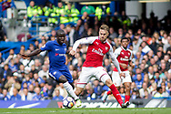 Aaron Ramsey of Arsenal and Ngolo Kante of Chelsea battle for the ball in midfield . Premier league match, Chelsea v Arsenal at Stamford Bridge in London on Sunday 17th September 2017.<br /> pic by Kieran Clarke, Andrew Orchard sports photography.