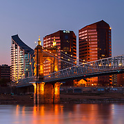 The Covington, Kentucky skyline and John A. Roebling Suspension Bridge over the Ohio River at dawn. Nathan Lambrecht/Journal Communications
