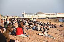 """© Licensed to London News Pictures. 28/02/2021. Brighton, UK. People out and about on the beach and seafront in Brighton, West Sussex. Last week, Prime Minister Boris Jonson announced his """"Roadmap Map' out of Lockdown with a gradual unlocking of Covid-19 restrictions over the next few months  Photo credit: Liz Pearce/LNP"""