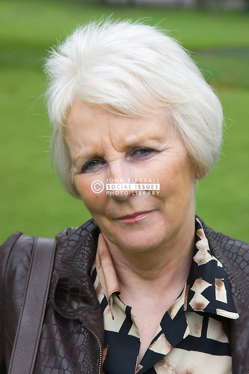 Portrait of a older woman in the park looking serious,