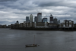 October 2, 2018 - London, England, United Kingdom - The skyline of Canary Wharf, London's financial district, is pictured under a cloudy sky, London on October 2, 2018. Business groups expressed alarm about a crackdown on low-skilled workers.The Confederation of British Industry said it would make a shortage of care, construction and hospitality workers worse, adding: ''Restricting access to the workers the UK needs is self-defeating. (Credit Image: © Alberto Pezzali/NurPhoto/ZUMA Press)