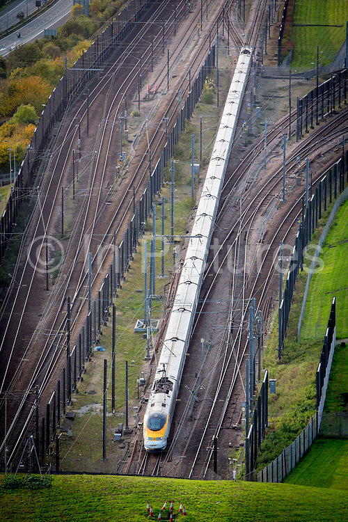 A Eurostar train enters the Eurotunnel, Cheriton, Folkestone, Kent. United Kingdom. The Channel Tunnel is a 50.45-kilometre rail tunnel linking Folkestone, Kent, in the United Kingdom, with Coquelles, Pas-de-Calais, near Calais in northern France, beneath the English Channel.