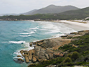 "Indian Ocean (or Southern Ocean according to Australian geographers) waves wash onto a fine white sand beach at Wilson's Promontory National Park in the Gippsland region of Victoria, Australia. Drive two hours from Melbourne to reach Wilson's Promontory, or ""the Prom,"" which offers natural estuaries, cool fern gullies, magnificent and secluded beaches, striking rock formations, and abundant wildlife."