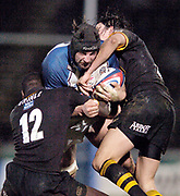 2004/05 Zurich Premiership, London Wasps vs Bath. Causeway Stadium, High Wycombe, ENGLAND:<br /> Bath lock Danny Grecock attacking run is stopped by the Wasps centres Ayolla Erinle {left] and Rob Hoadley<br /> <br /> Photo  Peter Spurrier. <br /> email images@intersport-images