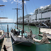 A sailor secures the  Historic Scow which sails for tourists form the NZ Maritime Museum, on the Auckland Harbour. Auckland, New Zealand, 3rd November 2010. Photo Tim Clayton.