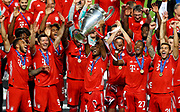 LISBON, PORTUGAL - AUGUST 23: Kingsley Coman of FC Bayern Munich lifts the UEFA Champions League Trophy following his team's victory in in the UEFA Champions League Final match between Paris Saint-Germain and Bayern Munich at Estadio do Sport Lisboa e Benfica on August 23, 2020 in Lisbon, Portugal.