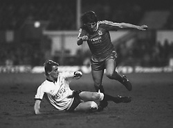 Peter Beardsley (Liverpool, r) tries to avoid a sliding tackle