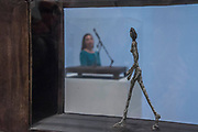 Figurine between two houses - the UK's first major retrospective of Alberto Giacometti (1901-1966) for 20 years.<br /> Celebrated as a sculptor, painter and draughtsman, he is famous for his distinctive elongated figures. With the help of Fondation Alberto et Annette Giacometti, Paris, Tate Modern's exhibition brings together over 250 works. Alberto Giacometti is at Tate Modern from 10 May to 10 September 2017