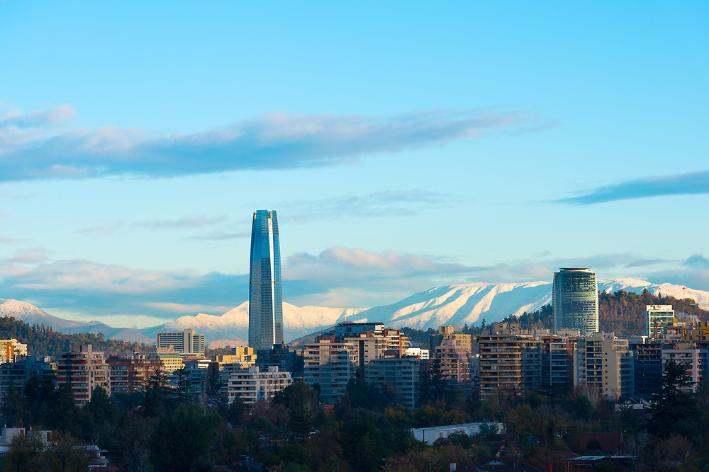 Skyline of residential buildings at Las Condes district with snowed hills in the back, Santiago de Chile