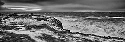 Men walking besides the coastline in stormy weather at the island Grimsey, north of Iceland - Menn á gangi við ströndina í Grímsey