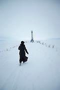 Woman walking to monument at Lake Baikal. Siberia, Russia