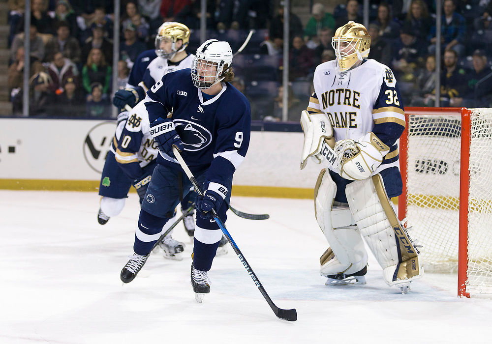 March 10, 2018:  Penn State forward Alex Limoges (9) sets screen in front of Notre Dame goaltender Cale Morris (32) during NCAA Hockey game action between the Notre Dame Fighting Irish and the Penn State Nittany Lions at Compton Family Ice Arena in South Bend, Indiana.  Notre Dame defeated Penn State 3-2.  John Mersits/CSM
