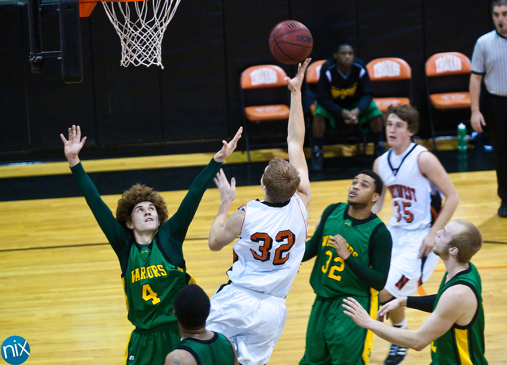 Northwest Cabarrus' Tyler Church takes a shot against West Iredell Monday night at Northwest Cabarrus in the first round of NCHSAA 3-A Playoffs. Northwest Cabarrus won 67-61 to advance. (Photo by James Nix)