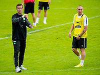 02/07/14<br /> CELTIC TRAINING<br /> AUSTRIA<br /> Celtic manager Ronny Deila (left) and captain Scott Brown at pre-season training