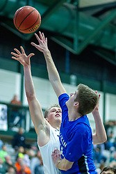 BLOOMINGTON, IL - January 04: Luke Yoder trys to shoot over an opponent during a college basketball game between the IWU Titans  and the Millikin Big Blue on January 04 2020 at Shirk Center in Bloomington, IL. (Photo by Alan Look)