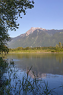 Mount Cheam from the edge of the Fraser River in the early Summer.  Photographed from beneath the Agassiz-Rosedale Bridge in Agassiz, British Columbia, Canada.
