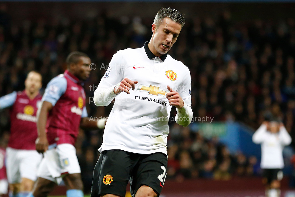 Robin Van Persie of Manchester United looks on. Barclays Premier league match, Aston Villa v Manchester Utd at Villa Park in Birmingham on Saturday 20th December 2014<br /> pic by Mark Hawkins, Andrew Orchard sports photography.