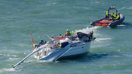 The RNLI tow a dismasted yacht during the Round the Island Race. Isle of Wight.<br /> Picture date: Saturday July 2, 2016.<br /> Photograph by Christopher Ison ©<br /> 07544044177<br /> chris@christopherison.com<br /> www.christopherison.com
