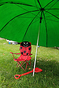 a child chair with large parasol