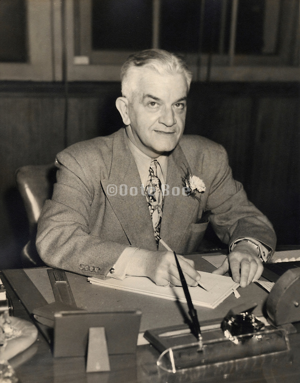 A portrait of a man behind his desk, 1940s