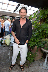 NOAH HUNTLEY attending the Warner Bros. & Esquire Summer Party held at Shoreditch House, Ebor Street, London E1 on 18th July 2013.