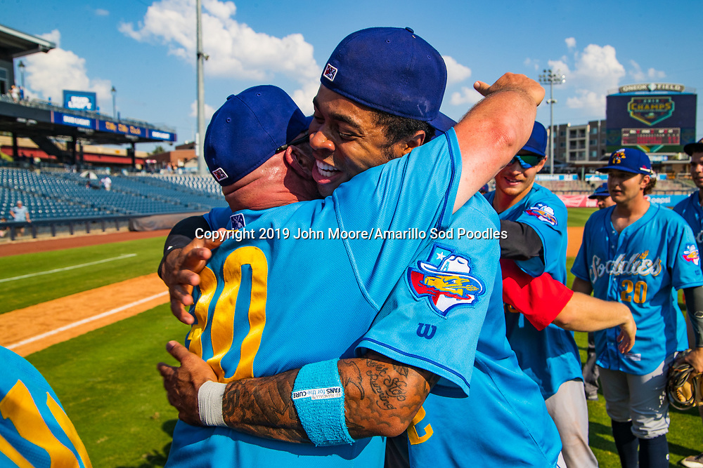 Amarillo Sod Poodles Manager Phillip Wellman and Amarillo Sod Poodles outfielder Buddy Reed (12) celebrates after the Sod Poodles won against the Tulsa Drillers during the Texas League Championship on Sunday, Sept. 15, 2019, at OneOK Field in Tulsa, Oklahoma. [Photo by John Moore/Amarillo Sod Poodles]