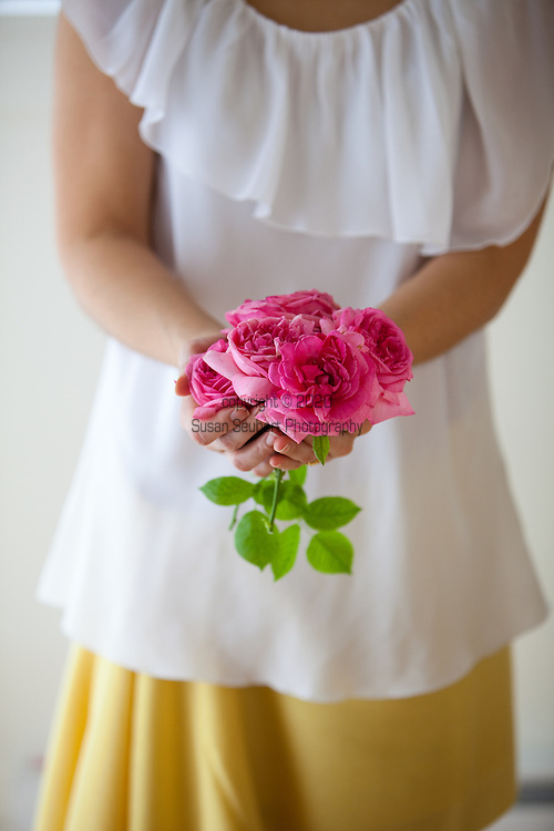 woman holding a handful of fresh roses