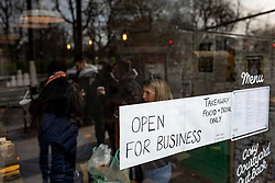 © Licensed to London News Pictures. 21/03/2020. LONDON, UK. A cafe only open for takeaway orders in Clapham Common, London, on 21 March 2020. The government yesterday ordered all public eateries to only serve takeaway food. Photo credit: Luke Dray/LNP