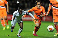 Nathan Dyer of Swansea city is challenged by Valencia's Andres Guardado.UEFA Europa league match, Swansea city v Valencia at the Liberty Stadium in Swansea on Thursday 28th November 2013. pic by Andrew Orchard, Andrew Orchard sports photography,