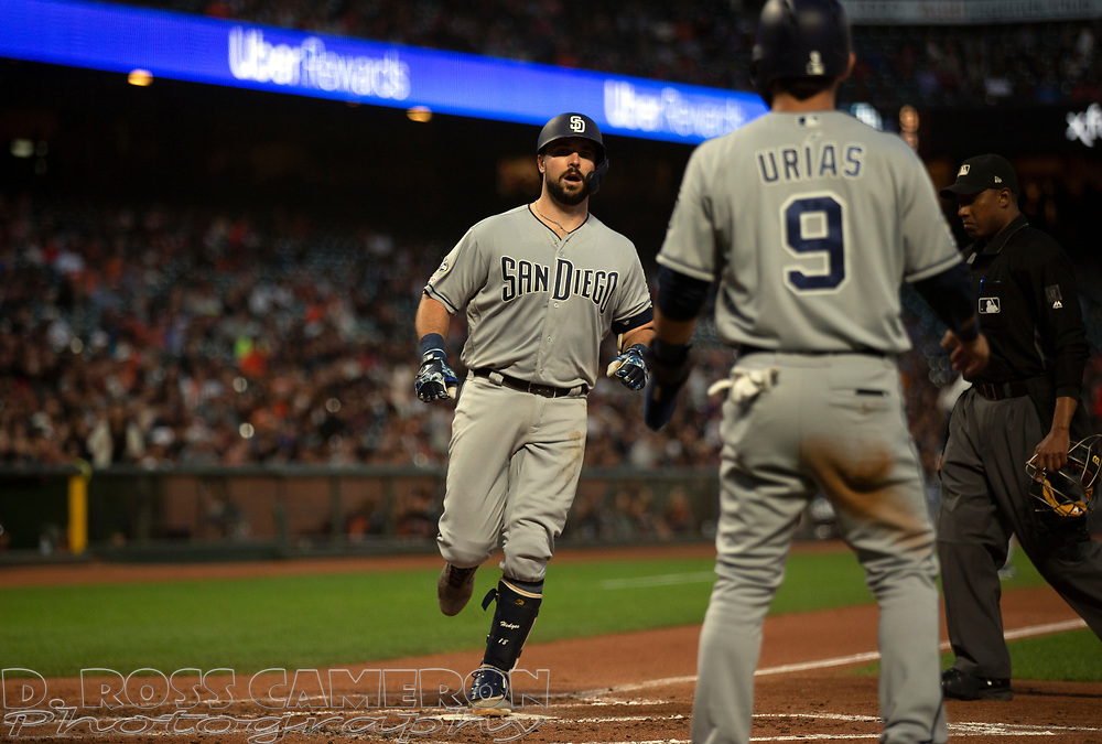 San Diego Padres' Austin Hedges, left, celebrates his two-run home run against the San Francisco Giants during the fourth inning of a baseball game, Thursday, Aug. 29, 2019, in San Francisco. Luis Urias (9) scored ahead of him on the play. (AP Photo/D. Ross Cameron)