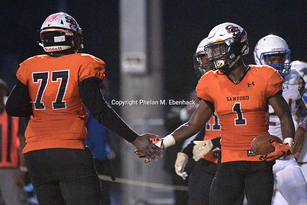 Seminole's Juri Sabb (1) is congratulated by Jarquez Mango (77) after catching a pass for a touchdown during the first half of a high school football game against Lyman Friday, Oct. 6, 2017, in Sanford, Fla. (Photo by Phelan M. Ebenhack)