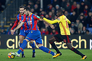 Luka Milivojevic of Crystal Palace (L) holds off Abdoulaye Doucoure of Watford (R). Premier League match, Crystal Palace v Watford at Selhurst Park in London on Tuesday 12th December 2017. pic by Steffan Bowen, Andrew Orchard sports photography.