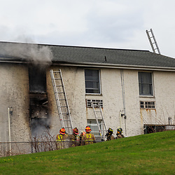 Lancaster, PA, USA- April 14, 2015: Firefighters work on extinguishing a motel fire.