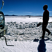After three days of work Inocencio  Flores will have cut up to thousand blocks of salt that was going even colchani in his(her,your) truck.  Salar de Uyuni ( Uyuni salt flat ) . Department  of Potosí  ( Los Lipez).  South West  Bolivia. <br /> Adult Altiplano America Andes Arid  Aridity Axe Barren  Bicycle Block  Bolivia Cleaver Color Colour Cone  Day Daytime  Department  Desert Desolate Desolation Dry  Exterior Extraction  Geography Hack Hard Hatchet  Heat Highlands  Horizon Horizontal Human  Latin America Lake  Los Lipez Lorry  Male Man Men Miner Mining Nature  Resource  Natural  One Outdoors Outside  Pan People  Person Pyramide Potosí  Production  Region Resource Rural Salar de Uyuni  Salt Flat  Salt Pan  Salt lake  Scenic Seasoning Shovel Single Shape South America  Southwest  Sud Sunglasses  Surface Travel  Truck West White Work  Worker Working