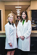 Women First physicians Dr. Rebecca Booth and Dr. Lori Warren pose for a portrait in the Baptist Hospital East Park Tower for M.D. Update magazine Thursday, April 16, 2015 in Louisville, Ky. (Photo by Brian Bohannon)