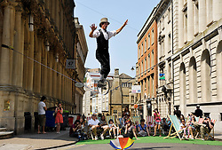 © Licensed to London News Pictures. 21/07/2013. Bristol, UK.  Picture of a high wire performer at Make Sundays Special in Bristol, an idea instigated by the city's elected Mayor George Ferguson.  Some city centre streets are closed to traffic and street performers entertain the crowds.  21 July 2013.<br /> Photo credit : Simon Chapman/LNP