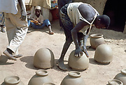 Making pots without a wheel. Nigeria c1966. Landscape format