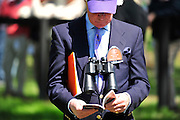 27 March 2010 : A race fan takes a look at the race program to pick a winner for the first race.