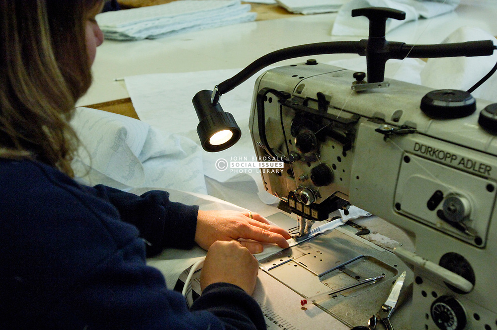 Remploy factory; Forest Hall; Newcastle; UK 2007, Remploy provides specialist employment services to disabled people and those who face barriers to employment, Woman working at sewing machine