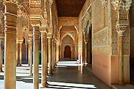 """Arabesque Moorish architectureof the Patio de los Leones (Court of the Lions)   of the Palacios Nazaries,  Alhambra. Granada, Andalusia, Spain. . The Alhambra is a palace and fortress complex located in Granada, Andalusia, Spain. It was originally constructed as a small fortress in 889 CE on the remains of ancient Roman fortifications. The Alhambra was renovated and rebuilt in the mid-13th century by the Arab Nasrid emir Mohammed ben Al-Ahmar of the Emirate of Granada, who built its current Alhambra palace and walls. The Alhambra was converted into a royal palace in 1333 by Yusuf I, Sultan of Granada. The decoration of The Alhambra consists for the upper part of the walls, as a rule, of Arabic inscriptions—mostly poems by Ibn Zamrak and others praising the palace—that are manipulated into geometrical patterns with vegetal background set onto an arabesque setting (""""Ataurique""""). Much of this ornament is carved stucco (plaster) rather than stone. Tile mosaics (""""alicatado"""") of The Alhambra, with complicated mathematical patterns (""""tracería"""", most precisely """"lacería""""), are largely used as panelling for the lower part. .<br /> <br /> Visit our SPAIN HISTORIC PLACXES PHOTO COLLECTIONS for more photos to download or buy as wall art prints https://funkystock.photoshelter.com/gallery-collection/Pictures-Images-of-Spain-Spanish-Historical-Archaeology-Sites-Museum-Antiquities/C0000EUVhLC3Nbgw <br /> .<br /> Visit our ISLAMIC HISTORICAL PLACES PHOTO COLLECTIONS for more photos to download or buy as wall art prints https://funkystock.photoshelter.com/gallery-collection/Islam-Islamic-Historic-Places-Architecture-Pictures-Images-of/C0000n7SGOHt9XWI"""